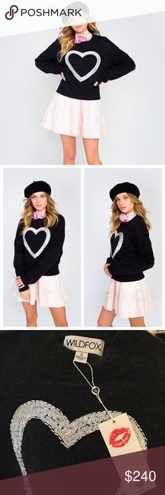Wildfox Glitz Heart Gainsborough Cashmere Sweater NWT!! Still in plastic from shipping - only took out for photos shown. Super cute Wildfox 2017 Winter and 100% Cashmere! Wherever you go, go with all of your heart! The Gainsborough Sweater is a fine-knit luxe cashmere sweater that is so soft that you won't ever want to take it off. Features long sleeves, banded hems and a white sequin embroidery detailed heart.  In Dark Charcoal. ***ASK ABOUT PRICE DROP TO GET REDUCED SHIPPING!! PRICE WILL…
