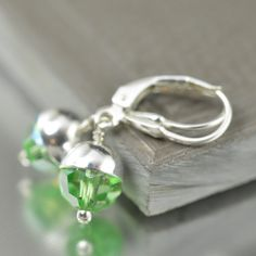 St Patricks day earrings featuring shimmering green Peridot Swarovski Austrian crystals by South Paw Studios jewelry artist Katy Mims southpawonline.com