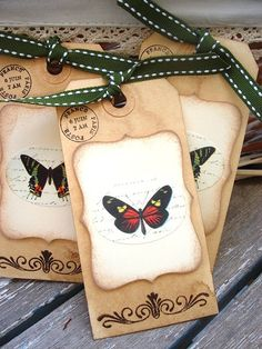 butterfly tags - I'd get the date stamp off to one side but like the idea.