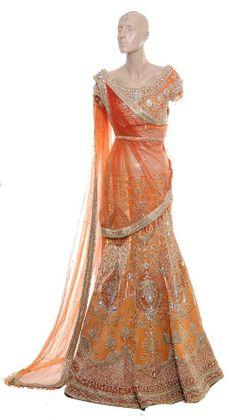 Shades of orange and mango can make a stunning bridal lengha
