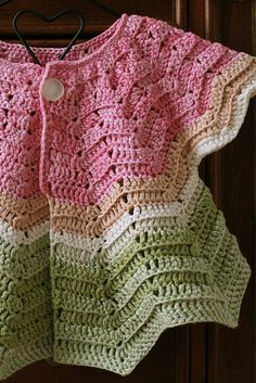 Watermelon colored baby cardigan -  from vintage pattern  http://www.freevintagecrochet.com/baby/no106-baby-set-pattern.html