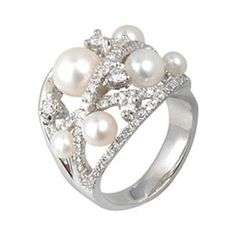 LOVE THIS - so unique for a Wedding Ring - pearls are timeless