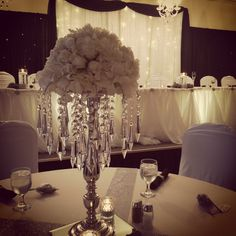 chandelier centrepieces with white rose crowns