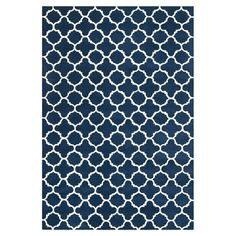 Anchor your living room seating group or define a space in your master suite with this hand-tufted wool rug, showcasing a quatrefoil motif in dark blue and i...