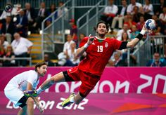 Day 16 - Hungary's Laszlo Nagy attempts to score as Croatia's Ivan Cupic looks on during their men's bronze medal handball match at the London 2012 Olympic Games at the Basketball Arena. MARKO DJURICA/REUTERS