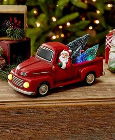 Little Red pickup truck being driven by Santa with Christmas Trees in the back