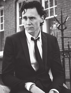 Tom Hiddleston looking dapper in black and white.