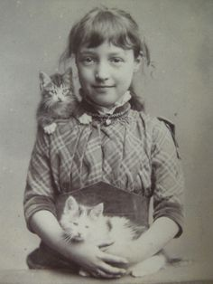 Little girl with kittens - c.1900