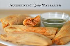 Homemade Authentic Chicken Tamales - http://www.sofabfood.com/homemade-authentic-chicken-tamales/ Make your friends and family feel special this holiday season when you take the time to make Authentic Chicken Tamales. Unique and definitely different than your typical holiday fare, these tamales will be devoured in no time! Tamales are anything but quick and simple, but there's nothing ...