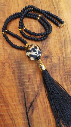 Long beaded black tassel necklace. Animal by AllAboutEveCreations