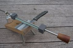 Knife Sharpening Jig - Homemade knife sharpening jig constructed from steel rods, lumber, a coupling nut, and a rod end.