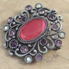 Pretty pink acrylic diamante brooch with pink purple and aurora borealis stones Complete with a pewter frame New and larger pink creation
