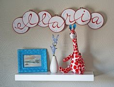 cute letters for a kids room...using cross-stitch frames, paint or stitch on letters and arrange.