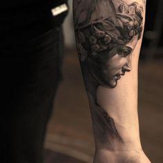 angel tattoo on inside arm by niki norberg