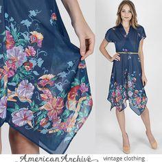 DESCRIPTION    Vintage 70s blue floral secretary boho party dress.  Draped wrap bodice with cap sleeves + deep v neck.  Gathered elastic waist