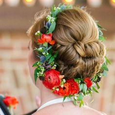 Encircle an updo with a pretty red ranunculus flower crown.