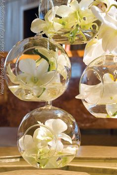 hanging orchids.  Glass globes can be hung from ledge around the room with Bamboo sticks from corner to corner.  Tealights/LED's  may also be added to add more light to the room