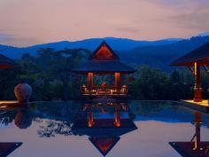 A fantastic resort in Thailand, neighboring Four Seasons Resort Chiang Mai.  Rates start at $800/night.  Stunning.