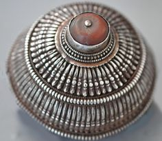 Lg silver cone for wearing in the hair or on a fabric back flap headdress, from Amdo Region, Tibet. Central stone is bakolite.  1930's. (private collection Linda Pastorino)