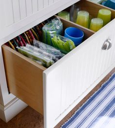 Great Divide - Large drawers are designated for seasonal items. Dividers keep paper plates, cups, and napkins organized and ready to go for the next backyard party. Items in these drawers can be switched out by season or occasion.