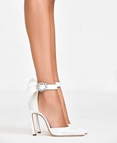 An elegant pointed D'orsay pump crafted from supple Nappa leather. These 105mm heels are punctuated with a glimmering crystal-embellished buckle that adds the perfect touch of shine to any bridal moment. Galia Lahav, The Perfect Touch, Bridal Shoes, Tea Party, Addiction, Dream Wedding, High Heels, Bows, Pumps