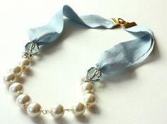 Baby Blue Ribbon Necklace with Pearls, Rhinestone Balls and Crystals. $55.00, via Etsy.