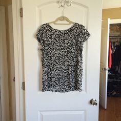 LOFT Blouse Beautiful preloved blouse from Ann Taylor LOFT. Black and white floral print. Size medium. Flutter sleeves. Button back (as seen in pic 3). LOFT Tops Blouses
