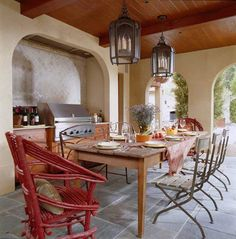 This outdoor kitchen has it all--a grill and under-counter fridge, plus a sink on the opposite side. - Traditional Home ® / Photo: Gordon Beall / Design: Stanley Hura