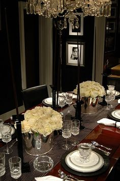 blk n wht frames ,check. white roses, check. chandelier, check.........wall paper & dining room table ..next!