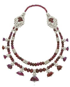 AN ART DECO RUBY AND DIAMOND NECKLACE, BY CARTIER. The two strands of graduated ruby beads with diamond-set geometric spacers, to the fringe of graduated taviz-cut rubies and buckle-shaped sides with single-strand back section, mounted in platinum, 1933, 38.5 cm, in red suede Cartier pouch. Signed Cartier. #Cartier #ArtDeco #necklace