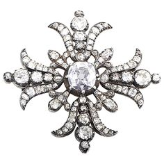 Victorian Diamond Silver Yellow Gold Brooch. A rare and luxurious find, this Victorian era brooch is absolutely stunning! The brooch is made of a combination of 14K yellow gold and silver and is set with ~3.50ct of diamonds. Lastly, the real show-stopper is the center stone, weighing in at ~1.90ct. c 1880s