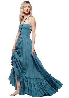 This crinkly halter maxi evening gown is made from breezy and comfortable rayon fabric. It features stretch smocked bodice and low strappy back. Ruffled detail and delicate pleats on following full skirt lends a feminine flair. Raw seam detailing on bottom hem and draw sting tie at back completes the look. It is perfect for evening, party and any special occasion.
