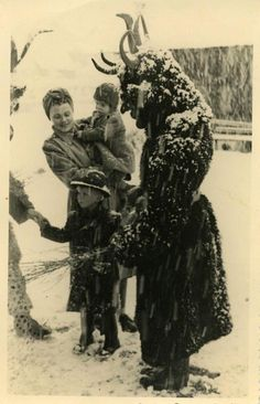 These children look sufficiently traumatized! Photo of Tyrolean children meeting Krampus, a sort of anti-Santa who hauls bad children off to Spain or somewheres.