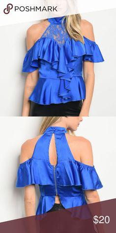 Royal Blue Top This is a beautiful top! It has a silky look to it, but it has a bit of stretch. Fabric Content: 100% Polyester Tops Blouses