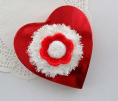 These lovely flower snowflakes are made using red acrylic and snow white funky fur eyelash yarn .    Lightwear and delicate pieces, made with love