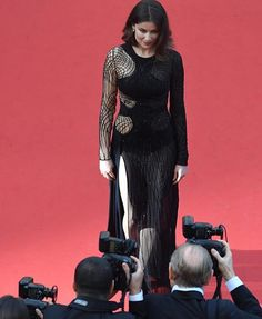 """Belgian and directed by the Dardenne brothersand starring Adèle Haenel """"The Unknown"""" tells the story of a female medical doctor who sets out to find the identity of an unknown young woman who died after she was refused surgery.  On this image Laetitia Casta wears a dress  from the Atelier @Versace_official Spring Summer 2016 Collection to attend the première.  More looks on ParisSocialDiary.fr  #ParisSocialDiary #Cannes #Cannes2016 #CannesFilmFestival #PSDlovesCannes by parissocialdiary"""