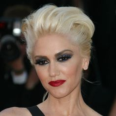 Smoky eyes, a classic red lip and platinum blonde hair, Gwen Stefani rocks a very glam updo.
