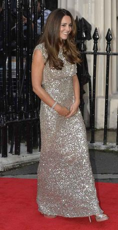 The Duchess of Cambridge glowed in a Jenny Packham dress covered with sequins and crystals and a pair of Jimmy Choo heels.   Prince William And Kate Middleton Get Dressed Up For Their First Night Out Without Prince George