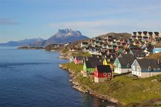 View over the brightly-coloured wooden houses of the Myggedalen neighbourhood of Nuuk.