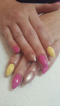 Pink with yellow gel nails