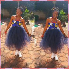 Tulle skirt meets African print tube top! White converse tops the whole do!