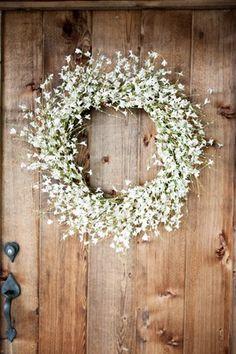 Rustic door with welcoming wreath.