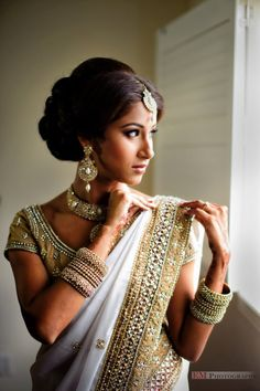 Thalabrala Sari - South Indian weddings, particularly in Andhra have a first half, in which the bride wears a red or green sari, and a second half in which she changes into a white sari (known as a thalabrala cheera)