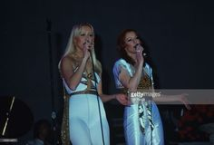 Agnetha Faltskog and Anni-Frid Lyngstad of Swedish pop group Abba perform on stage in 1977.