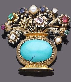 A multi gem-set giardinetto brooch The cabochon turquoise basket, issuing a spray of flowers set with old brilliant-cut diamonds, mixed-cut rubies, emeralds, sapphires and pearls, pearls remain untested, length 4.0cm.