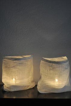 linen bag around glass candle holder