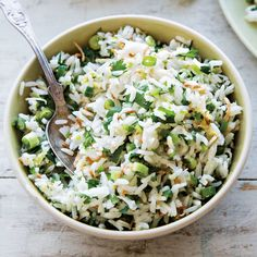 Coconut-Green Onion Jasmine Rice This coconut rice recipe transforms steamed jasmine into an aromatic dish that adds flavor to any meal. Try it on other grains, like quinoa or barley. Jasmine Rice Recipes, Coconut Rice, Toasted Coconut, Vegetarian Recipes, Cooking Recipes, Healthy Recipes, Onion Recipes, Rice Dishes, Kitchens