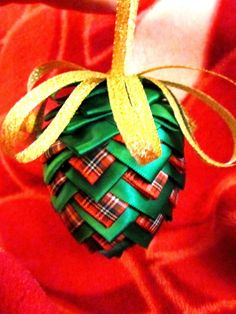 """Ribbon Pinecone Ornament Tutorial ~  :: Supplies :: *Styrofoam eggs - 3"""" or any size  *Ribbon - 7/8"""" (larger the ribbon, the less time it will take to fill your egg) *Thin ribbon to make the bow hanger at the top of the ornament. *Pins - any flat head pin. (applique pins are shorter) + a hat pin or some other long pin with a pretty head on it for the topper. *Scissors"""