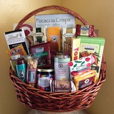 Gourmet Premium  Gift Basket: Crackers, Summer Sausage, Wisconsin Cheddar, Cookies, Lindt Chocolate Bar & Truffles, Ghirardelli Squares, Chocolate covered Peanuts & Cherries, Cocoa Mix, Olives, Toblerone Bar, Divinity, Dickerson Farms Berry Preserves, Soup Mix, Wafer Rolls, Dillon's Pecan Birttle and a delicious Peanut Roll. This large Gourmet Premium Basket is sure to please any recipient!