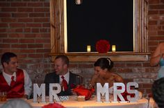 red and turquoise wedding.  silver painted paper mache letters MR and MRS at bridal table